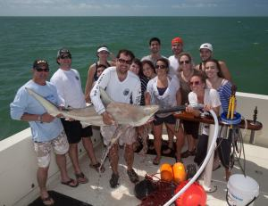 One of the school groups with Shiffman's team on the boat, after watching a blacktip shark. The pump in the shark's mouth helps it breathe when out of the water.