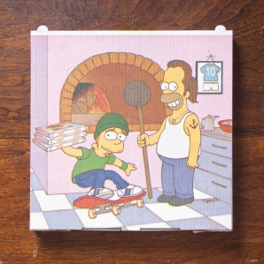 One of Weiner's favorite pizza boxes, from a pizzeria in Amsterdam, features artwork of Homer and Bart Simpson.