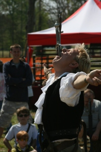 Dan Meyer at a Renaissance Festival swallowing two swords at once. (Photo: Kirk Hughes)